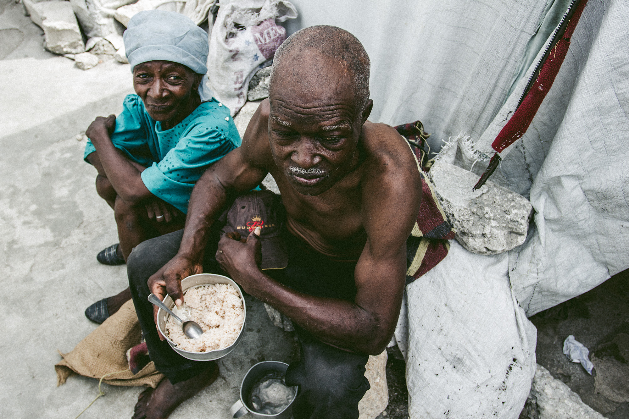 A Haitian refugee receives his daily ration